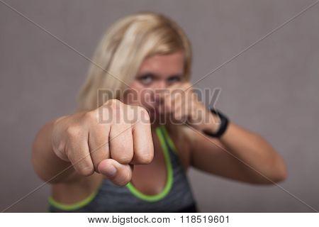 Dangerous Female Fighter Showing Fist