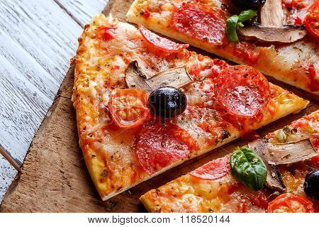 Delicious Fresh Pizza With Mushrooms, Cherry And Pepperoni Served On Wooden Table.