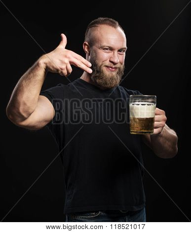 Bearded Man Standing With A Mug Of Light Beer