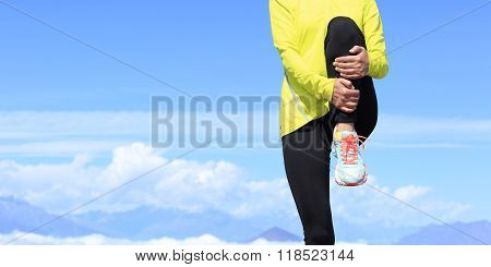 young fitness woman runner stretching before running on beautiful mountain peak