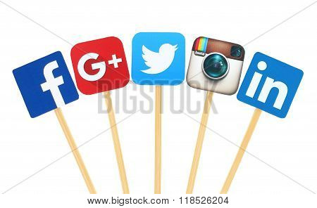Popular social media logo signs printed on paper cut and pasted on wooden stick