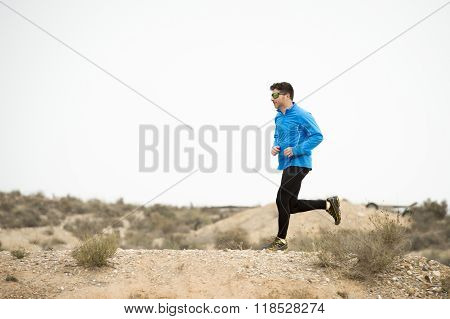 Sport Man Running On Off Road Trail Dirty Road With Dry Desert Landscape Background Training Hard