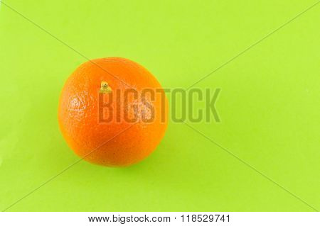 Whole Orange On Green Background