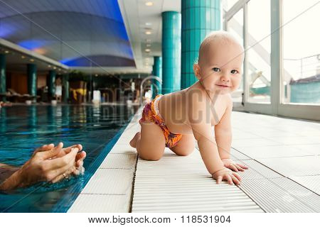 Smiling Charming Baby In Swimming Pool