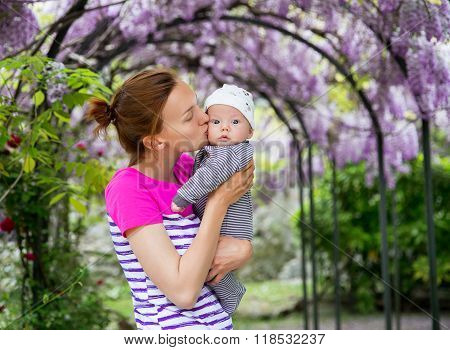 Baby and mother on nature