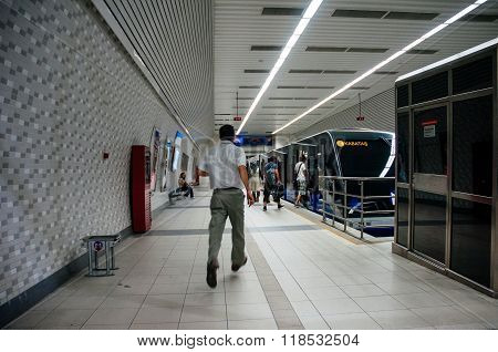 Man Running Trying To Catch The Istanbul Metro Train At Kabatas Statio