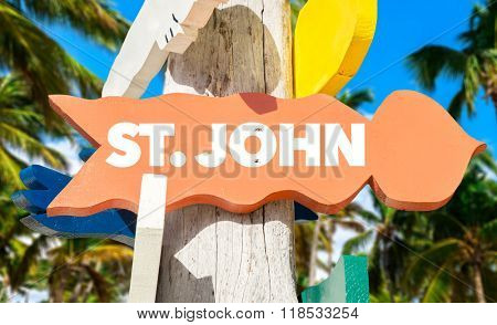St John welcome sign with palm trees