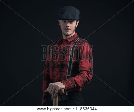 Fashionable Farmer In Red Checkered Shirt Holding Pitchfork.