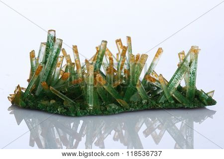 the green gypsum selenite on white background