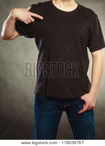Man Guy In Blank Shirt With Copy Space Pointing.