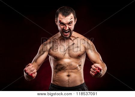 Fighter man. Boxer with blood on face and body. Aggressive man
