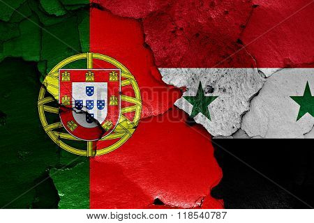 flags of Portugal and Syria painted on cracked wall