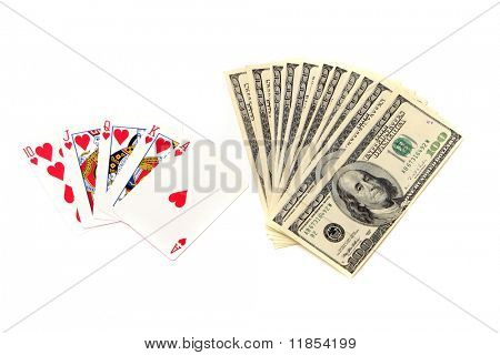 Royal flush poker hand and hundred dollar bills