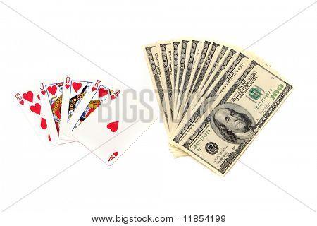 Royal flush poker hand and hundred dollar bills