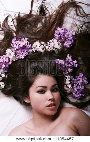 Beautiful asian woman with flowers on her hair