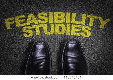Top View of Business Shoes on the floor with the text: Feasibility Studies