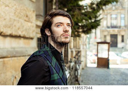 Elegant Man In Plaid On The Street