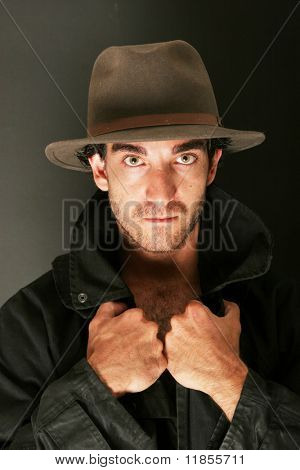 Attractive man in hat and trench coat