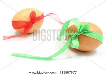 Easter Eggs With Green And Red Ribbons. White Background