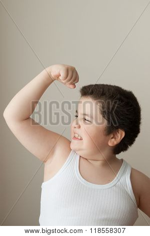 fat boy in a vest shows biceps muscles