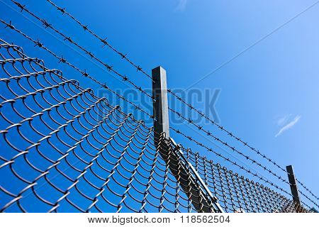 wire fence on sky background during the daytime