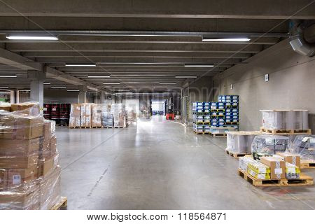 logistic, storage, loading, shipment and equipment concept - forklift loader and boxes at warehouse