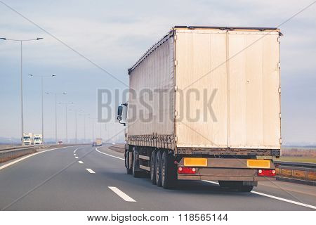 Commercial Trailer Truck In Motion On Freeway