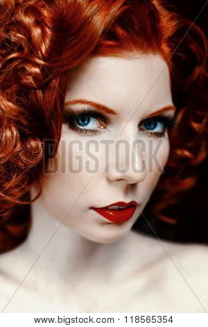 Pretty red-haired girl face with curls