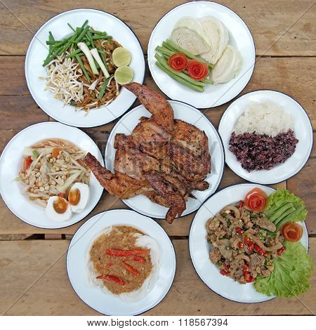 Famous North East Thai Food, Papaya Salad Or Som-tam Sliced Grilled Pork Spicy And Grilled Chicken W
