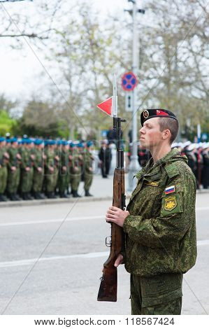 Russian soldier with a gun on parade in honor of the victory