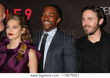 LOS ANGELES - FEB 16:  Teresa Palmer, Anthony Mackie, Casey Affleck at the Triple 9 Premiere at the Regal 14 Theaters on February 16, 2016 in Los Angeles, CA