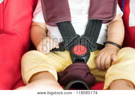 Close up Asian baby boy sitting in car seat.