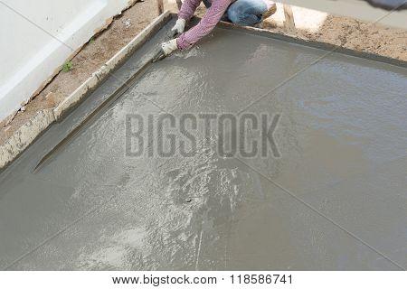 Plasterer Concrete Cement Worker Plastering Flooring Of House Construction