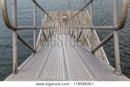 Metal Ramp To Pier With Seagull