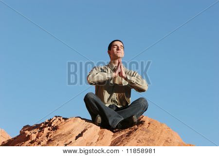 Stressed businessman meditating outdoors