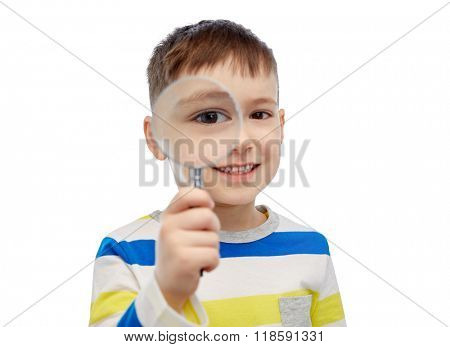 childhood, investigation, discovery, vision and people concept - happy little boy looking through magnifying glass