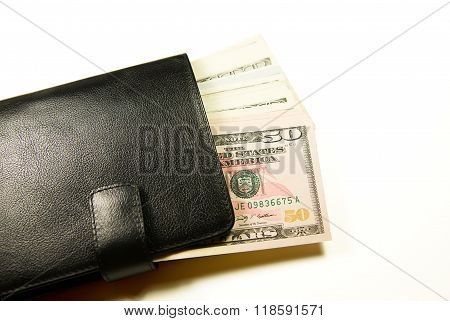 Black Wallet With Banknotes Of Us Dollars Inside