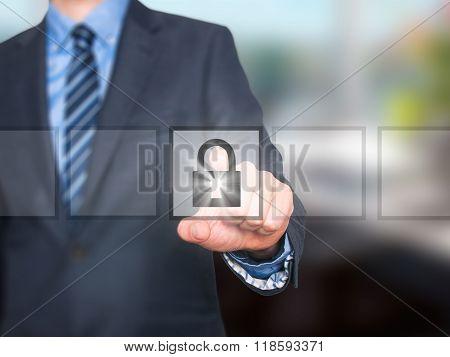 Businessman Selecting Padlock