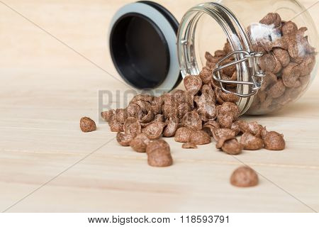 Chocolate Cereal Cornflakes Spilling To The Wood Surface