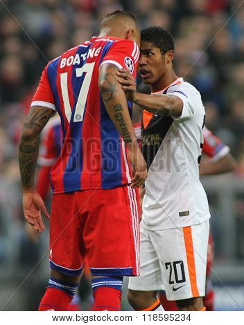 MUNICH, GERMANY - MARCH 11 2015: Bayern Munich's defender Jerome Boateng and Shaktar's midfielder Douglas Costa square up to each other during the UEFA Champions League match
