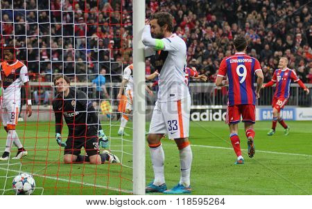 MUNICH, GERMANY - MARCH 11 2015: Shaktar's goalkeeper Andriy Pyatov on his knees after conceding a goal to Bayern Munich's forward Robert Lewandowski  during the UEFA Champions League match
