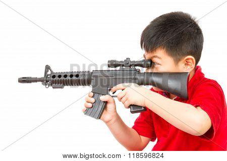 Asian Little Boy Playing Plastic Toy Ak47