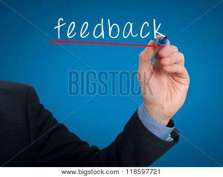 Businessman Hand Writing Feedback In The Air- Blue - Stock Photo