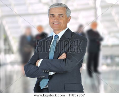 Businessman Arms Crossed In Lobby