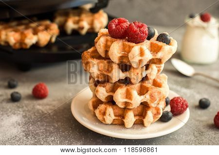 Homemade Belgian waffles with forest fruits,  blueberries, raspberries and  yogurt. Vintage styling.