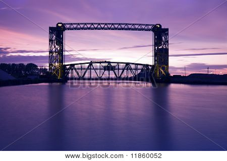 Sunset, Bridge And Two Lighthouses