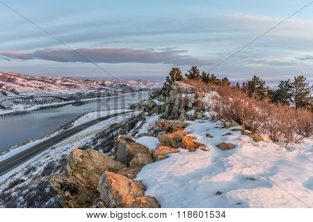 winter sunrise over Horsetooth Reservoir and Centennial Road near Fort Collins in northern Colorado