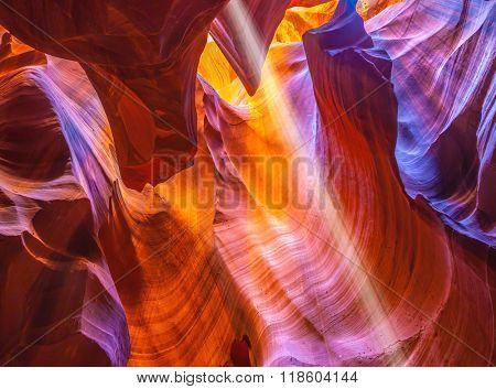 Magic ray of sunshine in the colored fantastic slot canyon Antelope.  The Navajo reservation, Arizona, USA