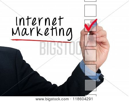 Businessman Hand Writing Internet Marketing And Check Listing Task