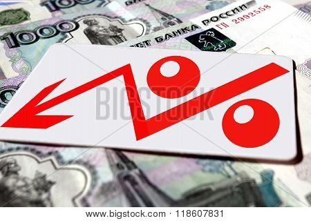Red percentage symbol on the background of banknotes